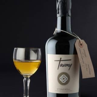 Stonewell Tawny finest Irish craft cider, with glass