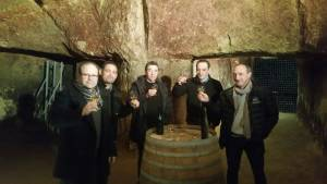 Sampling wine in the catacombs